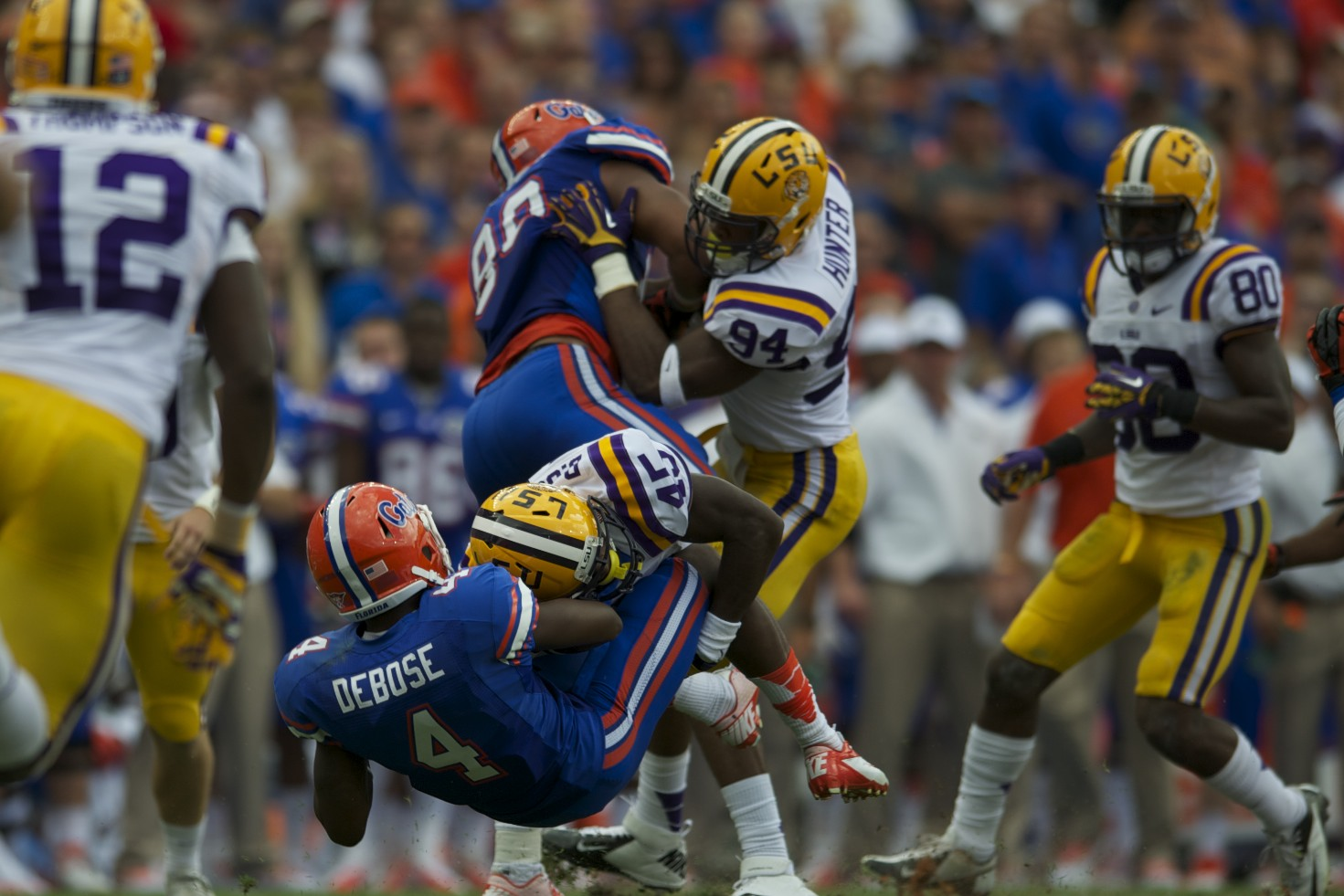 Andre Debose gets tackled by LSU defense in the first half during Saturday's game.