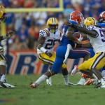 Florida's Mike Gillislee gets a first down for the Gators in the second half of Saturday's game.