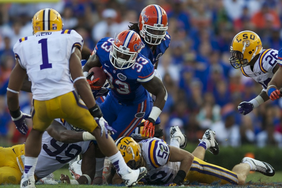 Florida's Mack Brown runs the ball for positive yardage in the third quarter of Saturday's game.