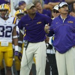 The LSU coaching staff awaits the verdict of a reveiew play in the second half of Saturday's game.