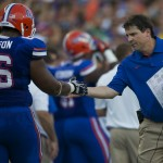 Florida head coach Will Muschamp high fives his player after a touchdown in the third quarter.