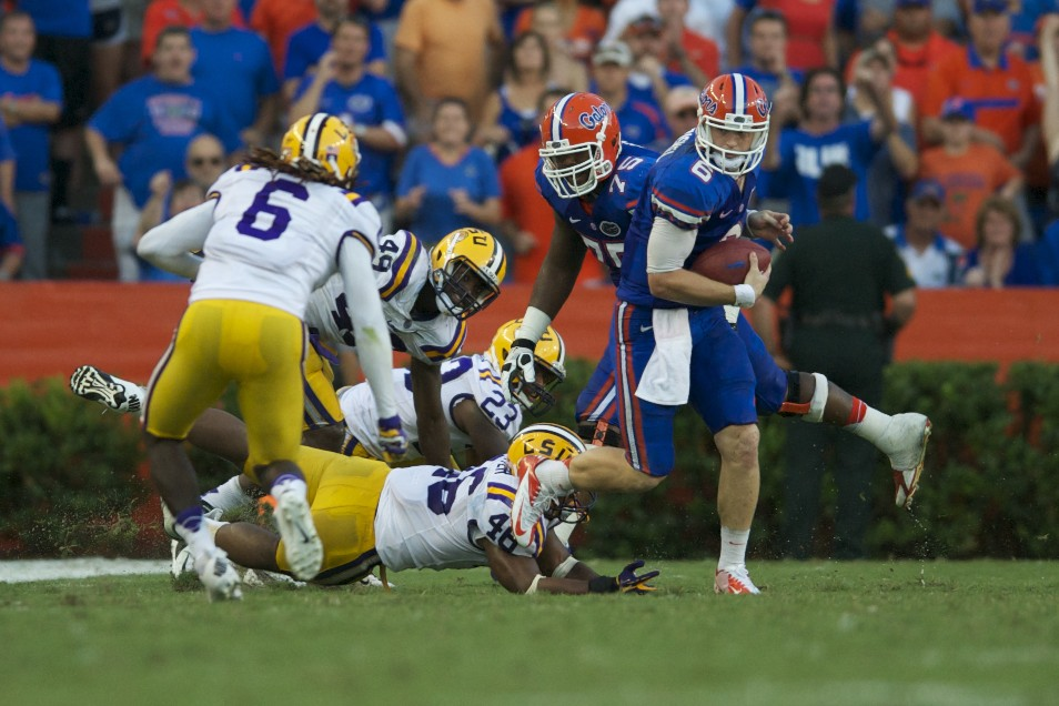 Quarterback jeff Driskel dodges the tackle for postivie yardage for Florida in the second half.