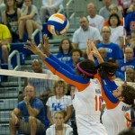 Middle blocker Chloe Mann and setter Taylor Brauneis go up for a block on the right side in the first set of Sunday's match.