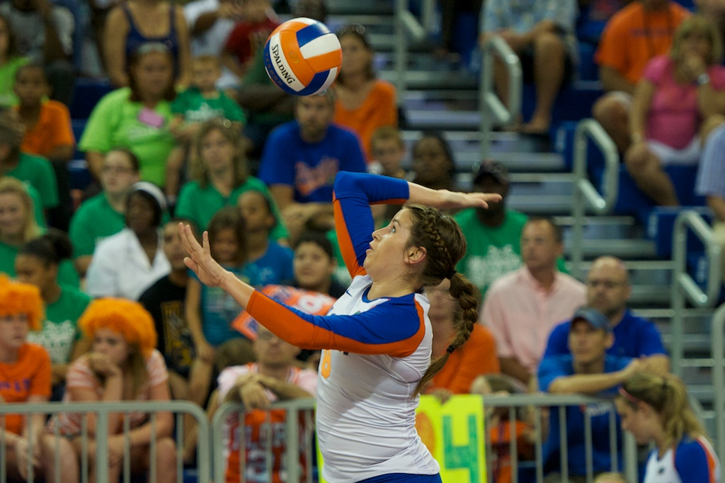 Setter Taylor Brauneis serves for the Florida Gators.