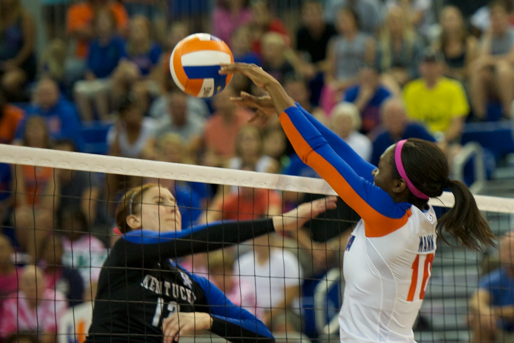 Junior Chloe Mann gets a block for the Florida Gators in the first set of Sunday's match.