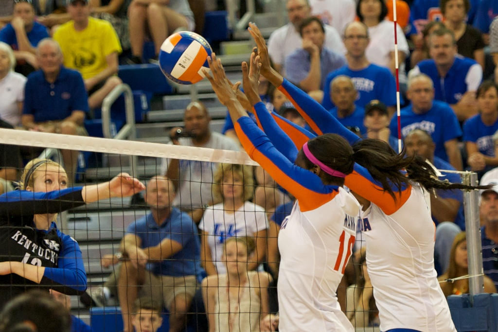 Junior Chloe Mann and Senior Tangerine Wiggs get a block for the Gators in the first set of Sunday's match against Kentucky.