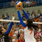 Outside hitter, Gabby Mallette, gets a block for the Gators in the third set of Sunday's match.