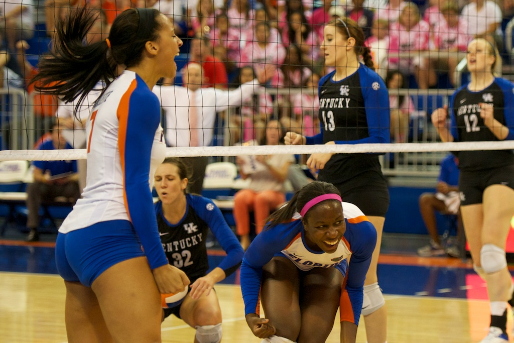 Outside hitter Gabby Mallette and middle blocker Chloe Mann celebrate after a block against Kentucky on Sunday.