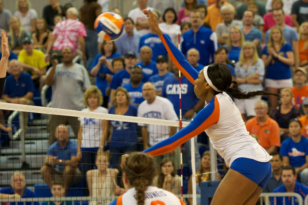 Right side hitter Tangerine Wiggs gets a kill for the Gators in the third set of Sunday's match.
