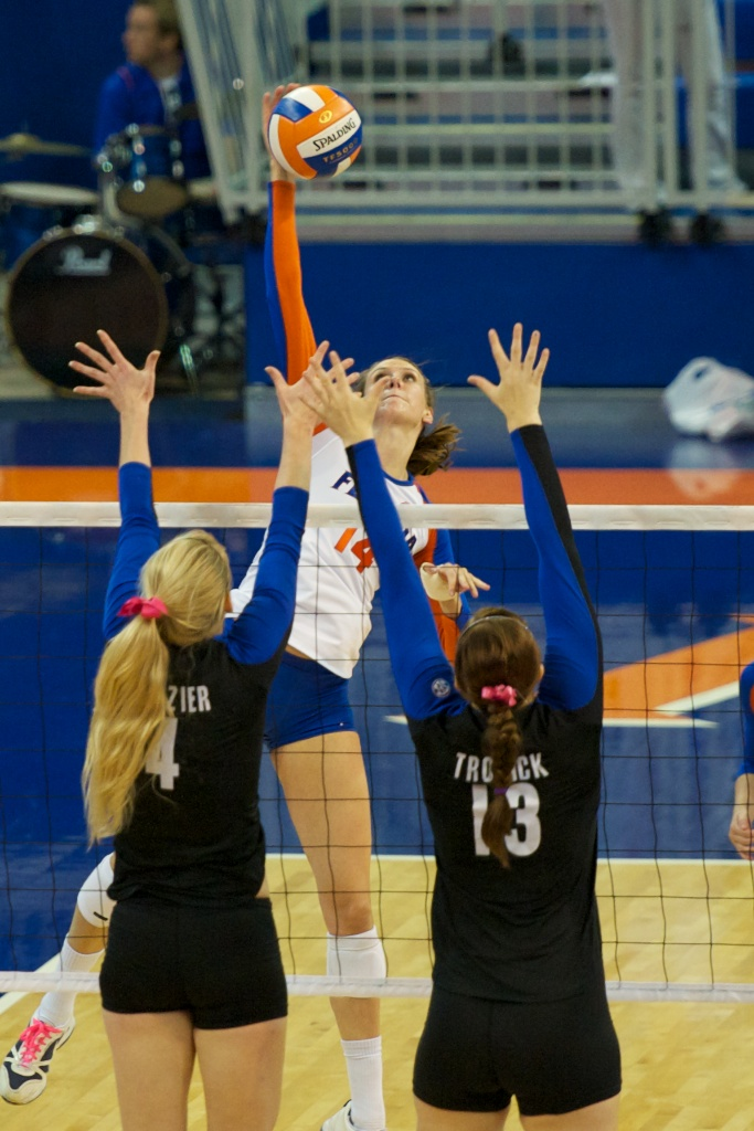 Senior Betsy Smith gets a kill for the Gators in the second set of the match against Kentucky on Sunday.