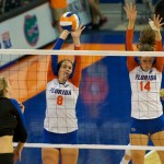 Junior Taylor Brauneis gets a block on Kentucky's outside hitter in the second set on Sunday.