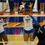 Outside hitter Gabby Mallette and middle blocker Chloe Mann get a block for the Gators during Sunday's match against the Kentucky Wildcats.