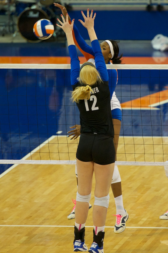 Tangerine Wiggs hits down the line for a kill in the second set of Sunday's match.