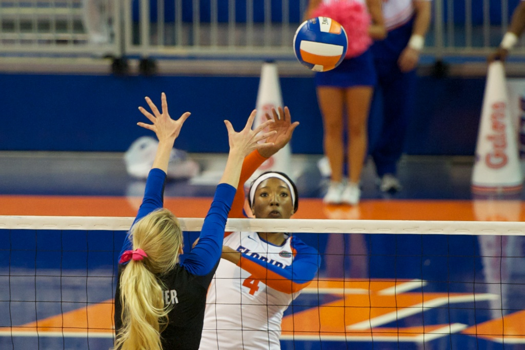 Senior Tangerine Wiggs gets a kill by avoiding Kentucky's block in Sunday's match.