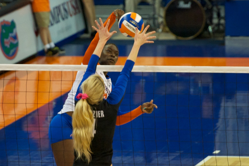 Chloe Mann gets a kill for the Gators in the second set of Sunday's match against the Kentucky Wildcats.