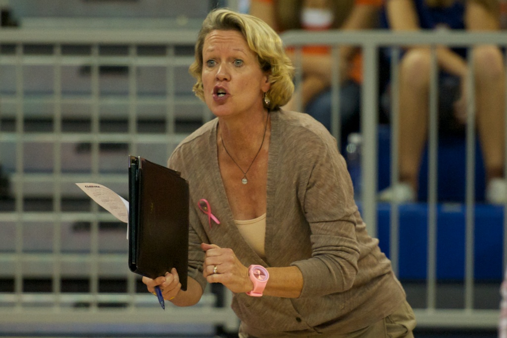 Head coach of the Florida Gators, Mary Wise, coaches her team through the 5-set match from the sidelines on Sunday.