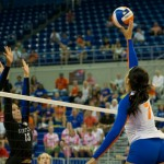 Freshman Gabby Mallette tips over the block and down the line in the third set against Kentucky on Sunday.