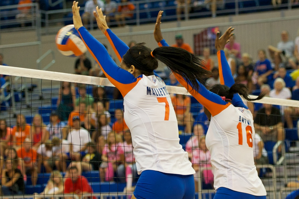 Outside hitter Gabby Mallette and middle blocker Simone Antwi get a block for the Gators during Sunday's match against the Kentucky Wildcats.
