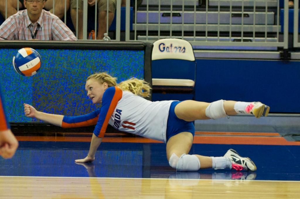 Defensive specialist Madison Monserez dives for the ball in the third set of Sunday's match against Kentucky.