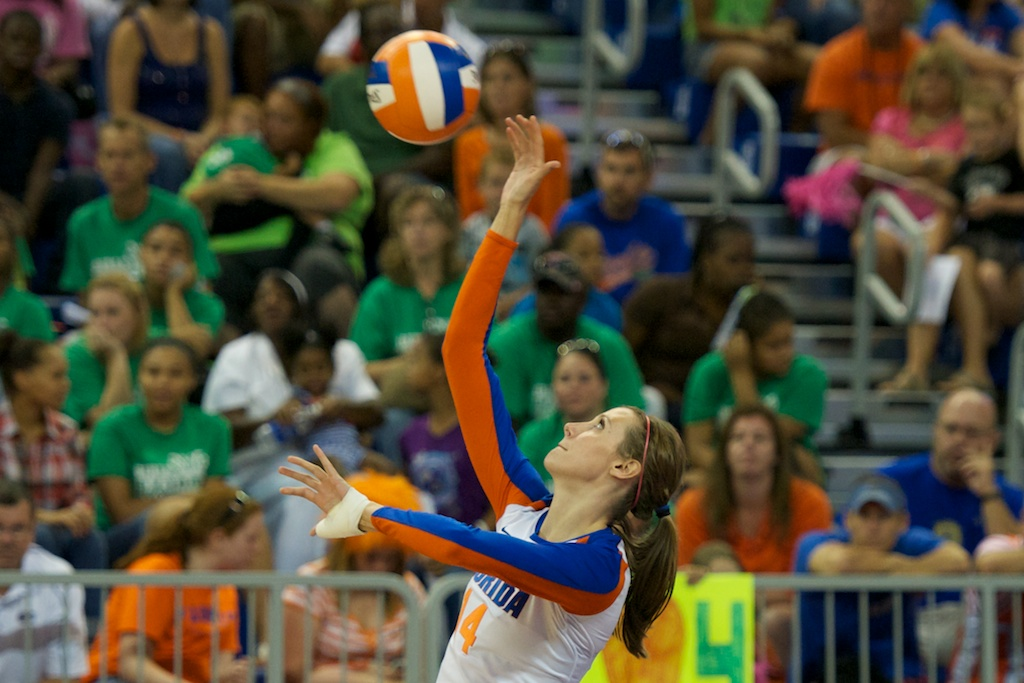 Senior Betsy Smith serves for the Gators