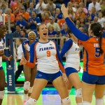 Freshman Ziva Recek celebrates with her team after she gets a kill against the Kentucky Wildcats in the final set of the match on Sunday.