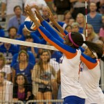 Middler block Chloe Mann and right side hitter Tangerine Wiggs get a block for the Gators in the fifth set on Sunday.