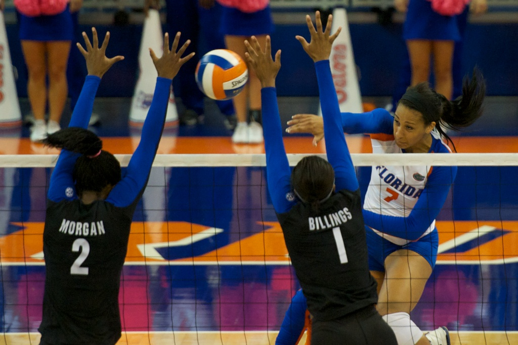 Outside hitter Gabby Mallette gets blocked by Kentucky in the fourth set of Sunday's match.