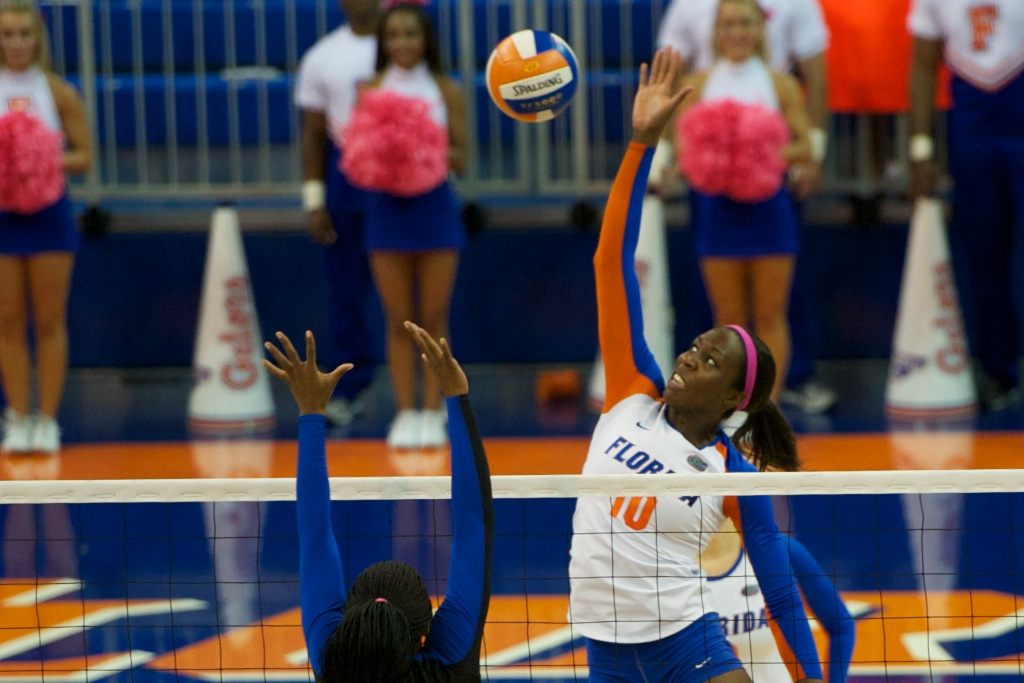 Chloe Mann gets a kill for the Gators in the fourth set of Sunday's match against the Kentucky Wildcats.