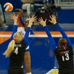 Tangerine Wiggs hits down the line for a kill in the fourth set of Sunday's match.