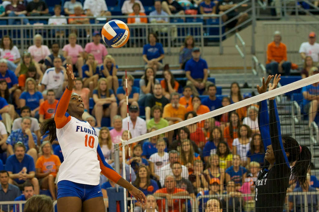 Middle blocker Chloe Mann tips over Kentucky's block in the fifth set of Sunday's match.