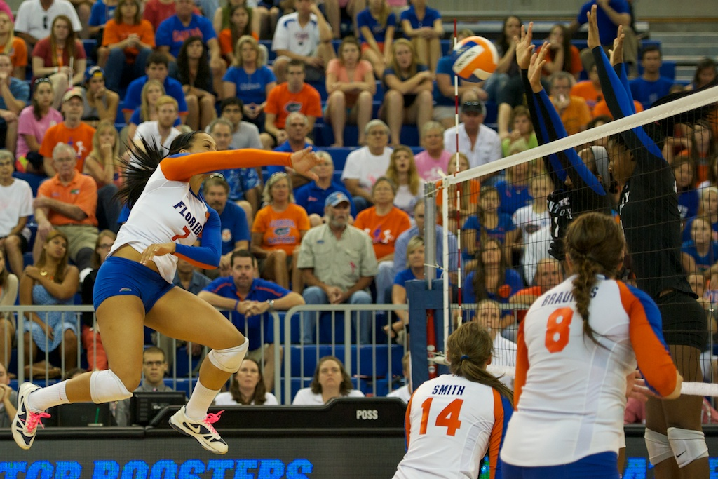 Freshman Gabby Mallette gets blocked by Kentucky in the fifth set on Sunday.