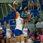 Holly Pole serves for the Gators in the fifth set.