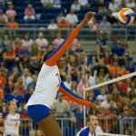 Tangerine Wiggs hits outside for the Gators in the fifth set on Sunday.