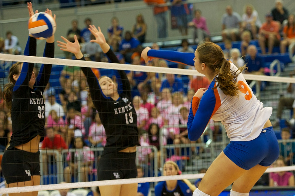 Freshman Ziva Recek hits around the block and down the line for a kill for the Gators in the fifth set Sunday.