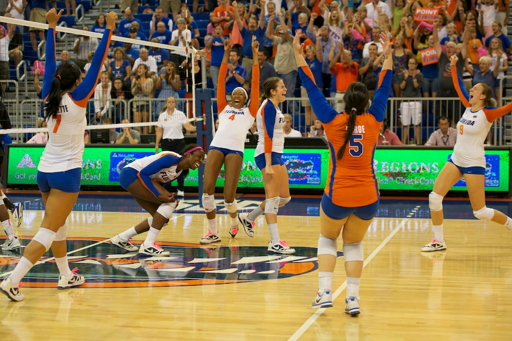 The Florida Gators celebrate their comeback victory after the final point of Sunday's match against the Kentucky Wildcats.