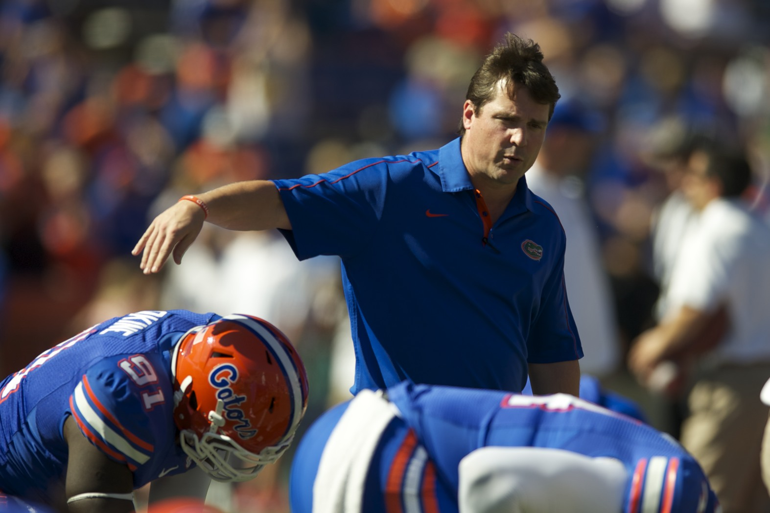 Florida head coach Will Muschamp encourages his team during warm ups before the game against South Carolina Saturday afternoon.