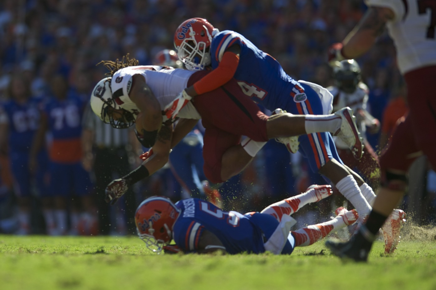 Florida's Andre Debose takes down a member of the South Carolina offense.