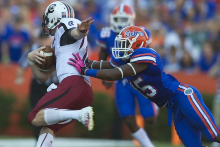 Florida's Loucheiz Purifoy tackles a member of South Carolina's offense.
