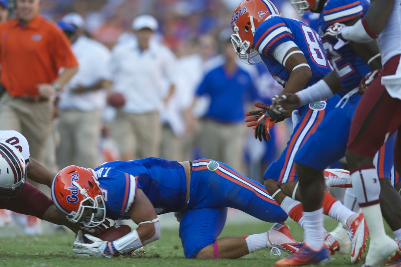 Runnning back Trey Burton recovers the fumble for a Florida first down.