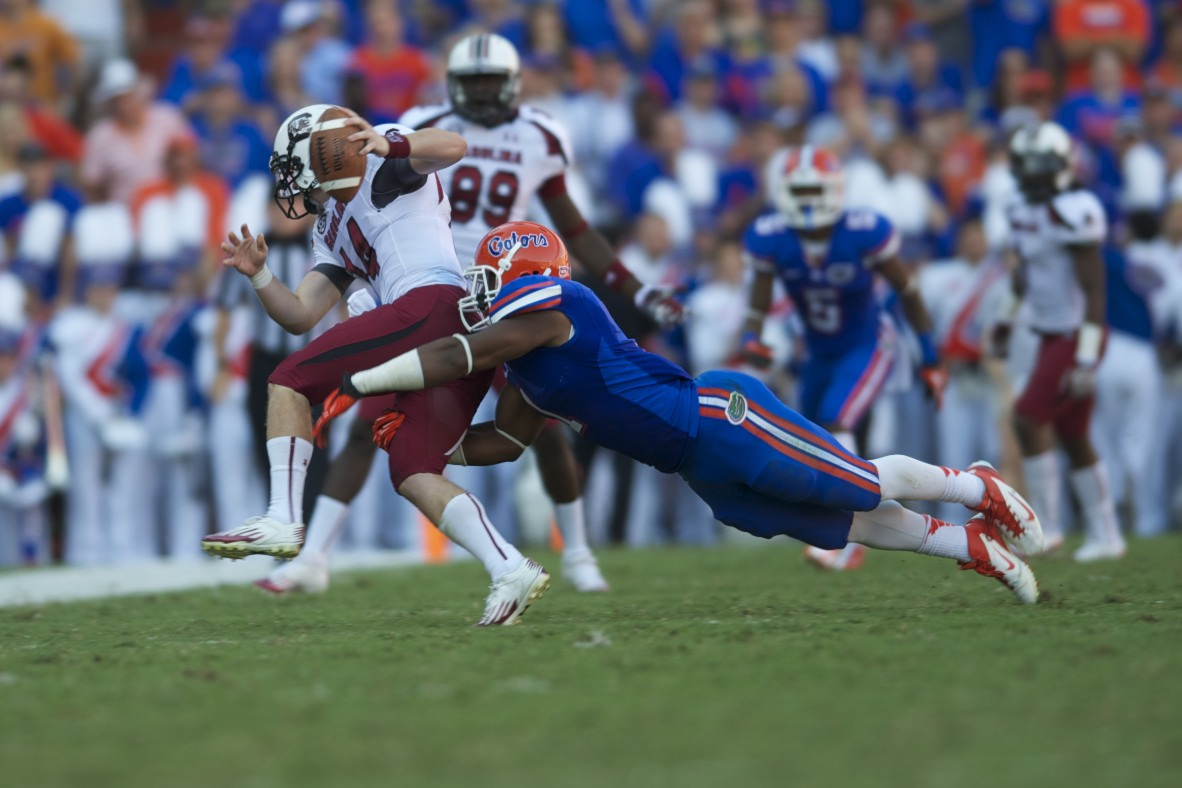 Florida's Bostic tackes South Carolina's quarter back Shaw to stop a first down.