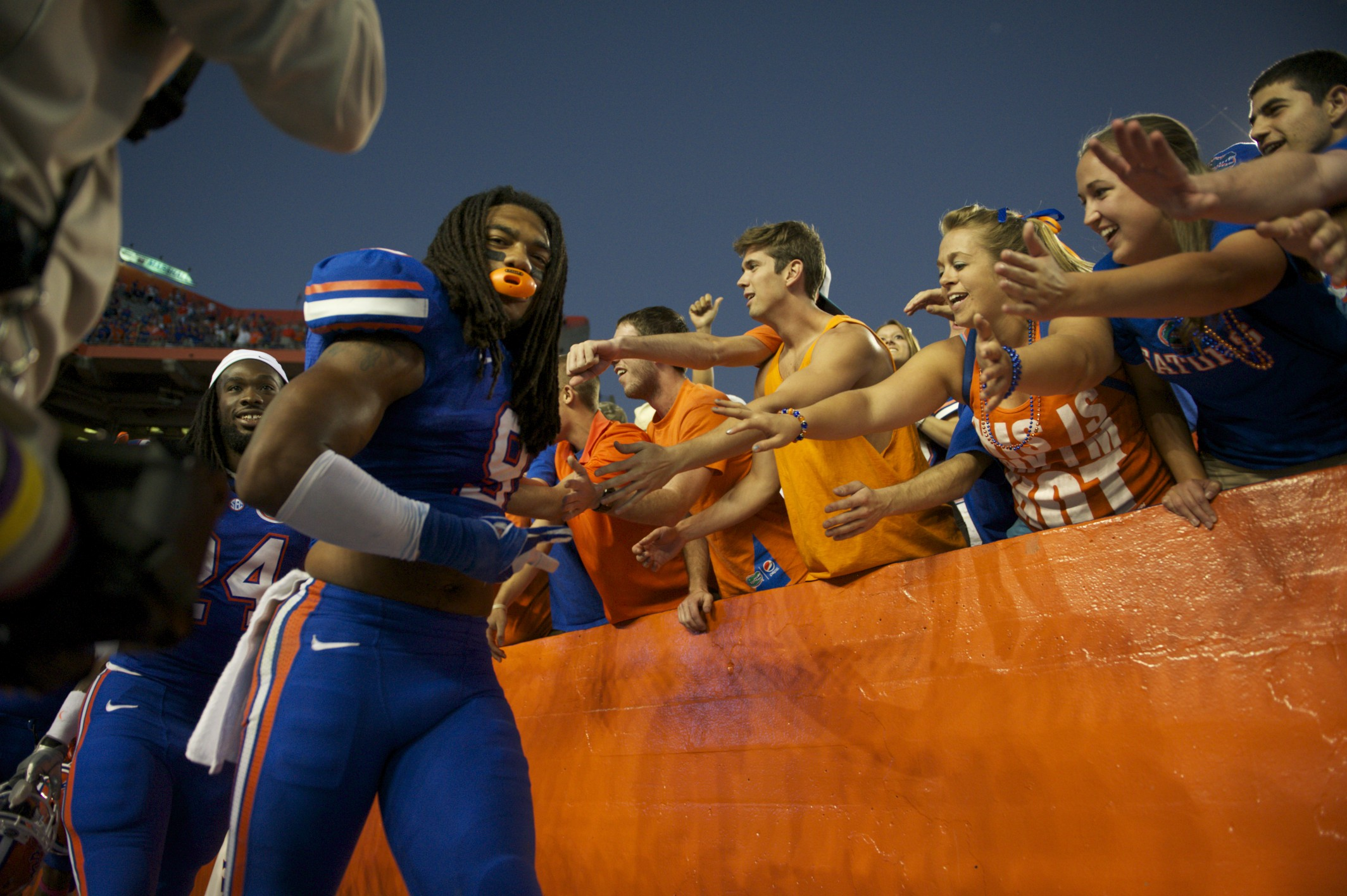 Florida players show their appreciation to the fans by high fiving them after their victory on Saturday.