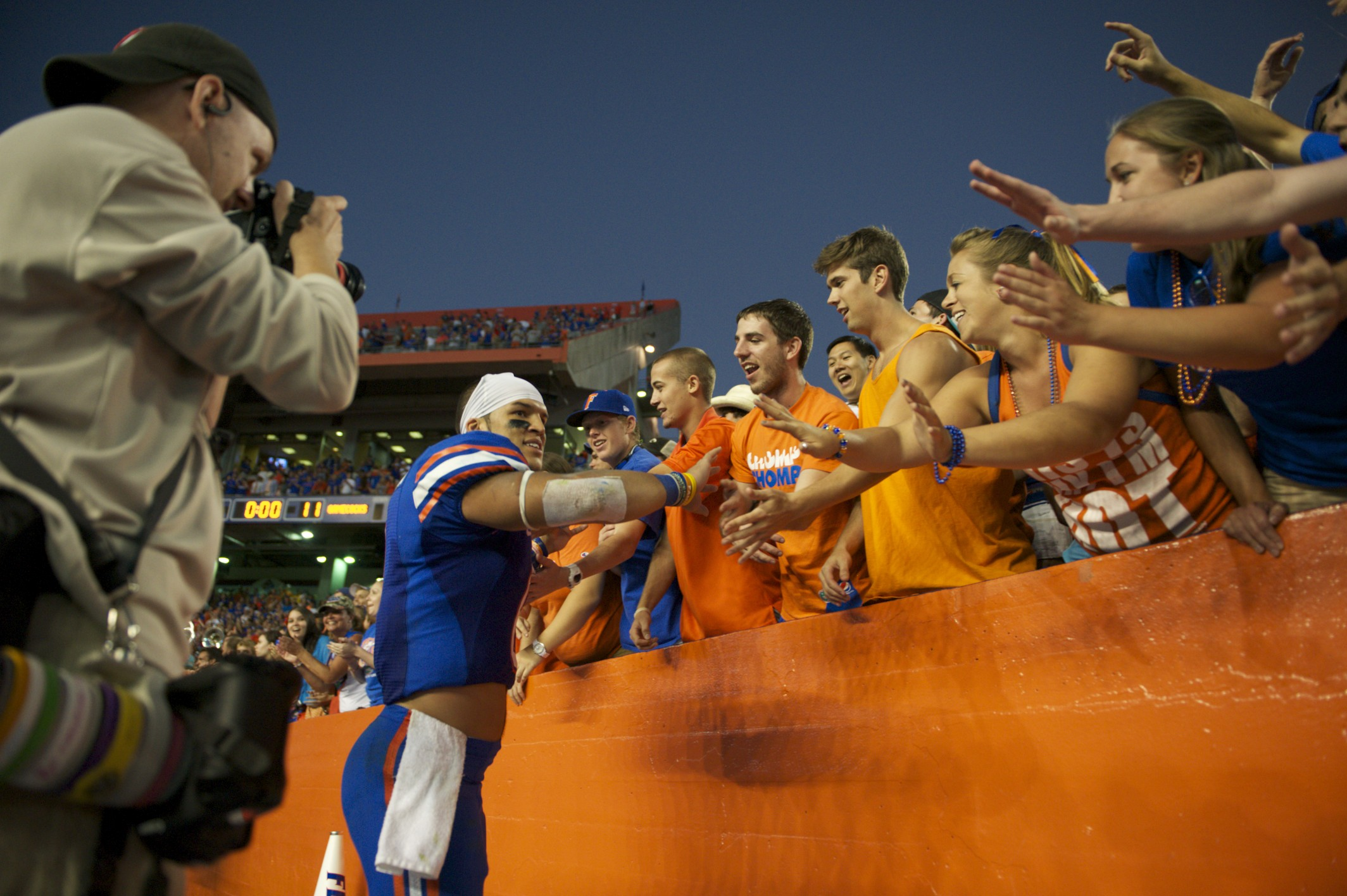Trey Burton shows his appreciation to the fans by high fiving them after his team's victory on Saturday.