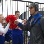 Trey Burton fist-bumps a cheerleader during Gator Walk.