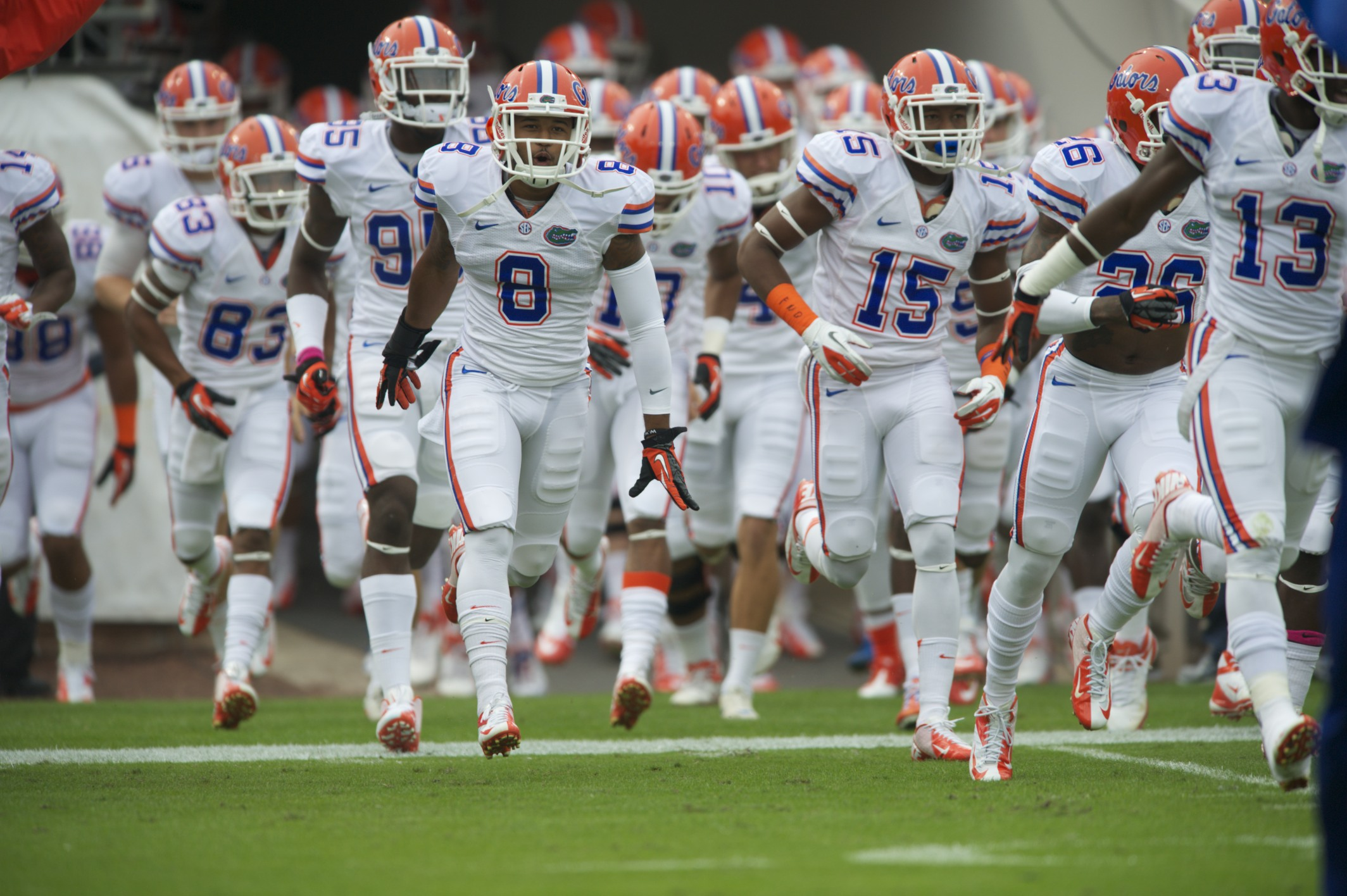 Florida Gators run out to take on the Gerogia bulldogs in Jacksonville, Fla. Saturday afternoon.