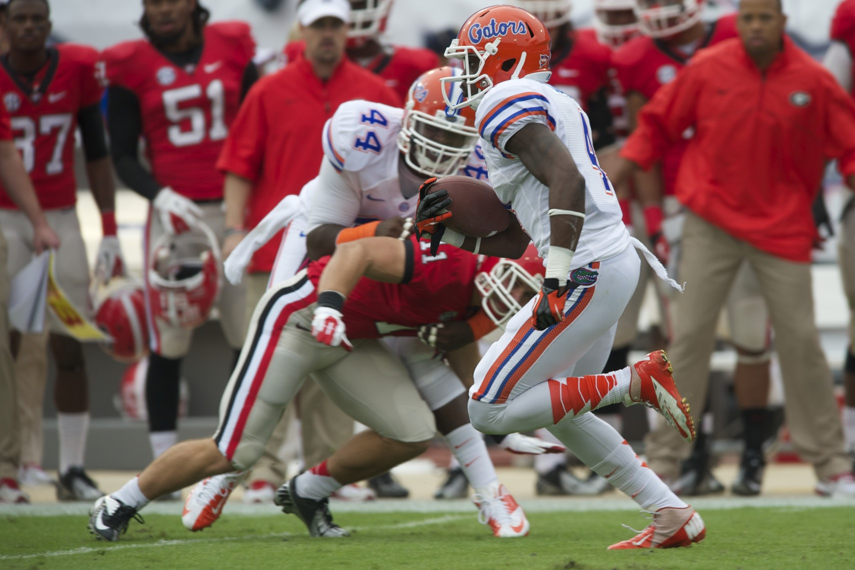 Florida's Andre Debose avoids the tackle with help of teammate, Leon Orr.
