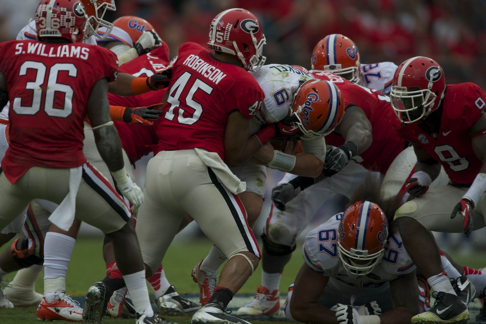 Florida's quarterback Jeff Driskel is taken down by Georgia's defense after a gain of yards in Saturday's game.