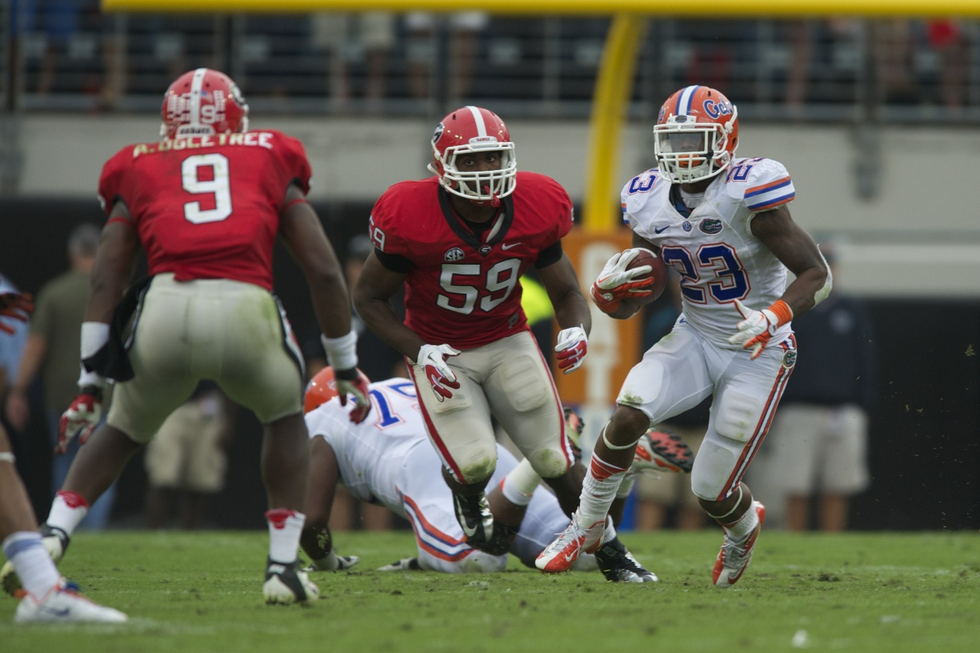 Running back Mike Gillislee gets a first down for the Florida Gators in the first half of Saturday's game.