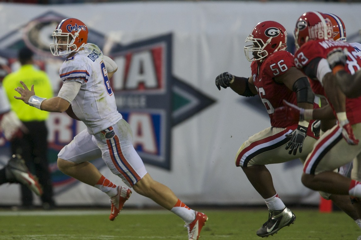 Quarterback Jeff Driskel runs the ball for a Florida first down in the second half of Saturday's game against the Georgia Bulldogs.