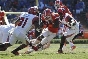 Mike Gillislee (23) gains yards for the Florida Gators in the first quarter of Saturday's game against Louisiana.