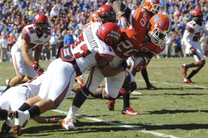 Florida's Omarius Hines (20) gets a first down for the Gators in the first quarter of Saturday's game against Louisiana's Ragin' Cajuns.